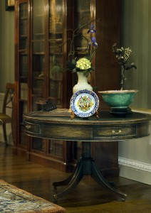 Michael Walton's library table with Le Chateau interior's green porcelain bowl.