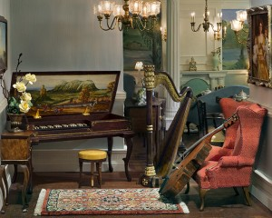 The American side music room. Ralph Partelow made the pianoforte and Ken Manning created the bass fiddle. Sandra Wall Rubin's flowers on stand by Patrick Puttock. Rug by Classic Carpet.