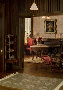 The parlor is furnished with Belter furniture by Stan Lewis and Betty Valentine.